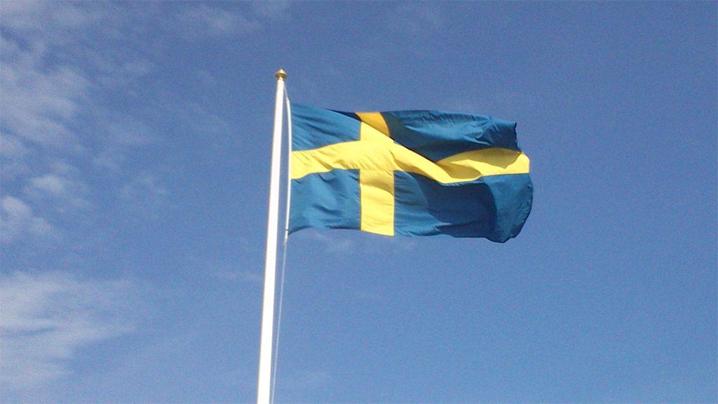 En svensk flagga. Fotograf okänd (Wikimedia Commons CC-BY-SA-3.0)